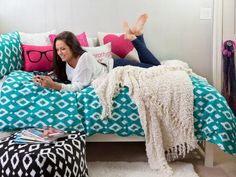 """Turn your bed into a daybed to create additional seating for friends. During the day, add decorative throw pillows against the back wall to turn the bed into a """"couch."""""""