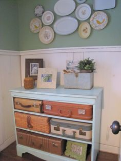 old dresser with vintage suitcase storage
