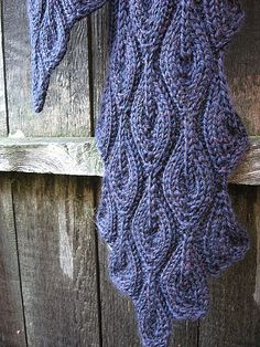 Free Pattern: snippetsandstash's Purple Flames. For pattern go to 'About this Pattern' on right and click on Candle Flame Scarf.