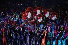 "Performers holding masks of David Bowie. His song ""Heroes"" played as the British team entered the stadium."