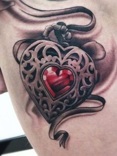 Tattoo Artist - Pete The Thief - heart tattoo *good idea to incorporate a ruby for daughter's birthstone