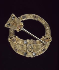 Hunterston Brooch, an early Christian brooch with panels of gold filigree combining Celtic and Anglo-Saxon styles, made in the west of Scotland or Ireland around 700 AD.