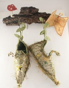 Fairy shoes displayed on a branch! This goes well with the pixie shoe pattern.