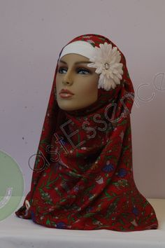 This elegant hijab well be perfect for any season. Stay beautiful yet modest with this one of a kind hijab.   This hijab is made from Silk Viscose blend and screen printed.   (Cap/Flower pin not included)  Approximately 28x75