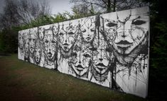 Wall of Faces by Iemza. In Reims, France.
