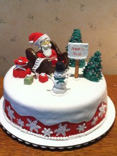Christmas Cake with Gum Paste Sants and Snowman.