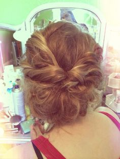 Updo Messy Bun perfect for prom, wedding, banquet, easy to do also! 1. Tease hair 2. Separate into half up half down, [bottom half make loose bun and pin to head] {top half curl then pull into loose pony} 3. Flip the loose pony through once, then pin excess curls around the bun! 4. ADD BOBBY PINS AND HAIRSPRAY.