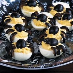 Deviled Egg Spiders - To assemble the spiders: slice a black olive in half lengthwise, that will become the body. Then cut the other half crosswise into thin slices to form the 8 creepy legs.
