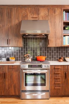 contemporary wood cabinets + vertical black subway tile