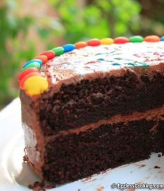 A simple chocolate cake recipe from scratch with step by step illustrations to bake a moist, decadent chocolate cake.