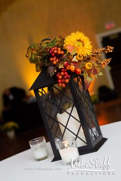 Flowers on the top of wedding lantern centerpiece. fall lantern centerpieces, wedding receptions, chicago wedding, shower centerpieces, wedding lanterns, fall weddings, wedding reception centerpieces, wedding reception decorations, flower