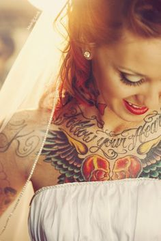 bride with diamond earrings and chest tattoo