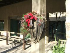 Western Christmas Twig Wreath made with an antique horse collar.