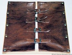 The Montessori Dressing Frames: The Buckle Frame. Made from leather, it is durable, realistic, and a sensory experience.