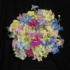 Learn how to make this bridal bouquet by clicking on the photo.  Tutorial by a professional wedding florist showing how florist supplies are used to keep flowers fresh.