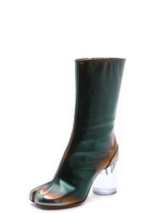 "3. Maison Martin Magiella Metallic two tones. Cloven-like toes. Plastic heel stumps. What could possibly go wrong? You're looking at it. The hot mess ""Brushed Effect Tabi Boots"" is sort of a boot-meets-sandal psychedelic love child, and retails for $873. But can we gush over that luscious green leather for a moment? If it had only stopped there. Source: shopbop.com  #flipflop #heel #freeyourtoes"
