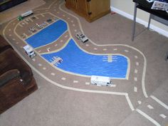 Roads, airport, lake all taped out on floor for cars, planes, and boats. Could add train station and trains??