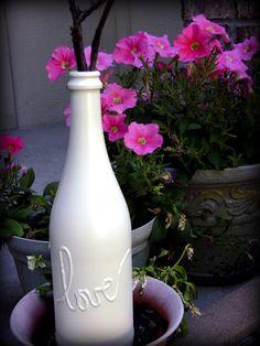 another wine bottle decor idea.. hot glue gun and a nice matte white spray paint