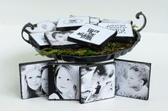 "Photograph Tiles: 2x2"" scraps of wood, print photos and photo descriptions (sized to fit onto pieces of wood) onto cardstock; cut out and mod podge photos on fronts and descriptions on backs of wood; use black paint or ink pad to cover edges of wood and pictures for distressed/aged look; mod podge over to seal"