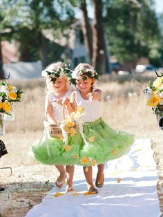 Flower Girls tossing petals down the aisle