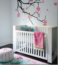 Designer Peter Wilds from boutique, The Cross created a chic modern nursery for baby girl. Love the pink and white pouf!