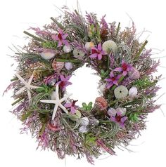 Orchid Island Seashell Wreath ~ Graced with lavender orchids combined with natural shells & succulents tucked around the shells, beach grass loops, bamboo sprigs & lavender oats.