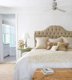 timeless neutral bedroom with tufted headboard