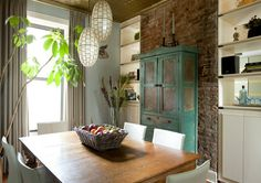 love the exposed brick and distressed paint on the cabinet.