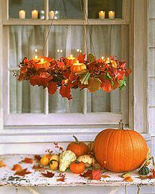 Pumpkin Chandeliers - -  I like the little pumkins alone on my table