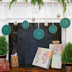 FA-LA-LA Garland - Make your fireplace or a blank wall sing with these homemade ornaments. Trace the outside of different-size embroidery hoops onto a roll of canvas. Cut out the circles and paint each with green chalkboard paint; let dry. Place the painted circles in the hoops and add hanging ribbon. Use chalk to write a festive refrain.