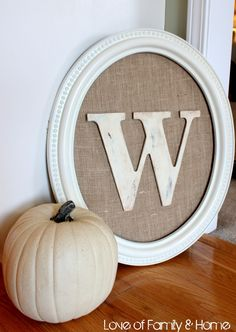 Framed monogram wall hanging using burlap and Hobby Lobby letter and paints via loveoffamilyandhome.net!