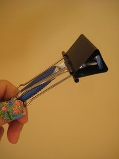 Use a large binder clip as a makeshift razor cover while traveling!