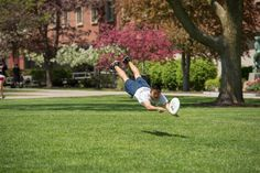 Students play frisbee on the Quad in the Spring