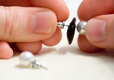 Use buttons to keep earrings together during travel.