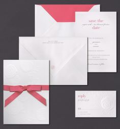 Our Embossed Rosette top fold invitation is shown here thermography printed in peony and charcoal.
