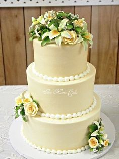 Ivory, yellows and greens wedding cake