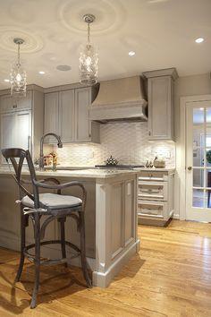 Beautiful gray cabinets and basket weave back splash!!