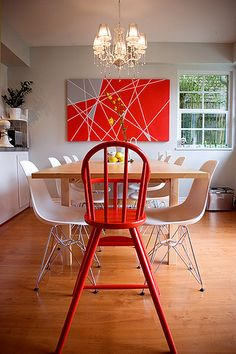 Red chair and art #diningroom tables, chairs, chandeliers, pendant light, ceiling design, wallpaper, mirrors, window treatments, flooring, #interiordesign banquette dining, breakfast table, round dining table, #decorating