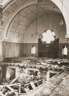 Prayerbooks lie scattered on the floor of the choir loft in the Zerrennerstrasse synagogue, destroyed on Kristallnacht. November 10, 1938.