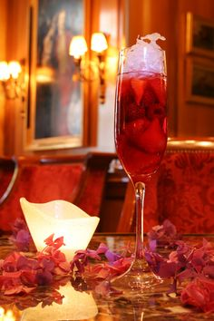 """Hotel George V famous """"George Fizz""""...a mix of champagne, Orange jouice, Guava Juice, Strawberries and Rasberries! So refreshing..."""