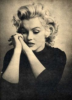 Marilyn Monroe. I love how she's not super smiley. We forget that she struggled a lot with depression, and here we see a bit of the real Monroe.