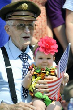World War II U.S. Army Air Corps veteran John R. Bishop, 94, holds his great granddaughter Aubrey McLucas , 11 months old, during a Memorial Day service in Cresson, Pa., on May 28, 2012.