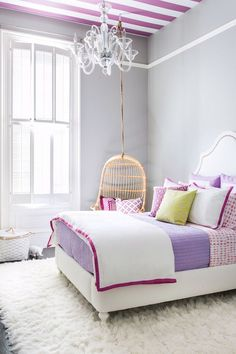 bright small bedroom with purple accents. Beautiful striped ceiling in white and purple.  For E's room.