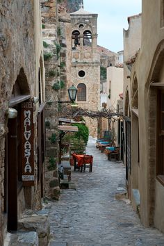 an alley in monemvasia, greece  in my case, it's the street of the swordsmiths in Tirana, where Macalla is followed and attacked