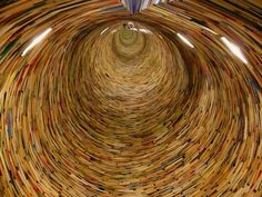 BOOKS TO INFINITY -- This crazy miracle in a library in Prague was designed by Slovakian artist Matej Kren. There's a mirror inside so the tunnel of books looks endless when you lean into it.