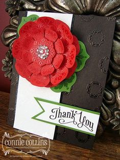 handmade card ... gorgeous!! ... huge layered flower ... black card base with red, white and green ... luv the clear embossing .... DaydreamMedallion & Floral Frames ... Stampin' Up!