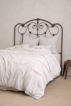 Pretty iron headboard + bed