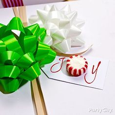 Add a *sweet* touch to presents with a peppermint on your gift tag! Click to see lots of sweet DIY gift wrap ideas.
