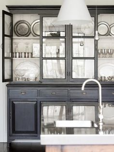 china cabinet painted black with white on the inside.