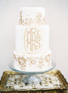 Gold Flaked Wedding Cake   photography by http://marissalambertphotography.com/
